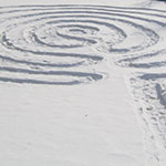 labyrinths made out of snow in the winter/grass in the summer that provide people a path to the sacred